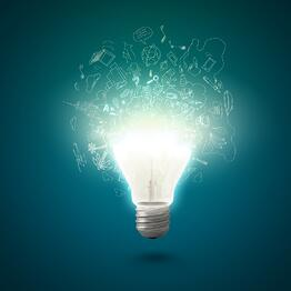 Conceptual image of electric bulb with business sketches.jpeg