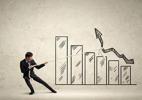 Image of young businessman pulling graph. Chart growth concept-1.jpeg